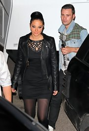 Tulisa Contostavlos was all edge in a slick leather jacket layered over an equally-cool cutout dress.