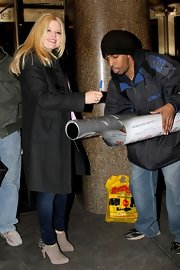 Megan Hilty signed autographs in a black felted wool coat and edgy studded boots.