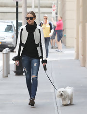Olivia Palermo balanced out her boxy blazer with a pair of skinny ripped jeans.
