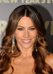 Sofia Vergara went for a soft lip look at the premiere of 'New Year's Eve,' wearing a frosty  light warm pink lipstick.