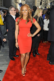 Melanie Brown showed off her toned figure in this fitted red frock.
