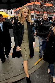 Stacy Keibler layered a simple black coat over her lace-up sheath.