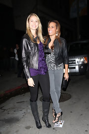 Stacy Keibler gave her black attire a pop of color with a ruffled purple blouse.