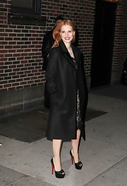 Jessica looked classic in this black wool coat with contrast velvet binding.