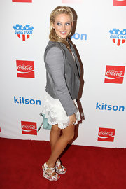 Stephanie Pratt looked girlish at the Coca Cola 125th anniversary in floral print wedges.