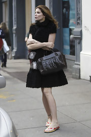 Stephanie Seymour was a head turner on the streets of NYC with this LBD and crocodile bowler bag combo.