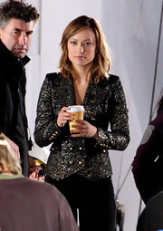 Olivia Wilde looked lovely on set of her new film in a knockout gilded blazer and black slacks.