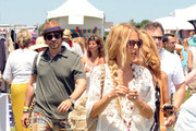 Stylist to the stars Rachel Zoe rocks a loose lace kaftan as she enjoys a day out at the annual Super Saturday event at Watermills, New York with husband Rodger Berman. The new parents had a day off from looking after baby Skyler as they enjoyed the charity event.