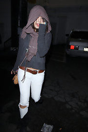Vanessa Hudgens wore a tan leather belt with a brass buckle with her ripped white jeans.