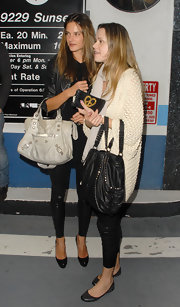 "Super model and new mom Alessandra was seen at Trousdale nightclub with a friend. She kept things low-key in a pair of leather leggings and beige ""City Bag""."