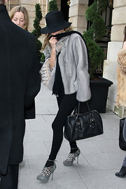 Kate Moss hit the streets of Paris carrying a black leather Longchamp bag.