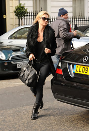 Kate Moss looked sleek in all black carrying a matching leather bowler bag.