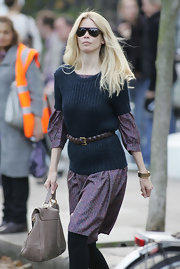 Claudia was spotted in London where she paired a printed dress with a knit sweater and brown leather belt.