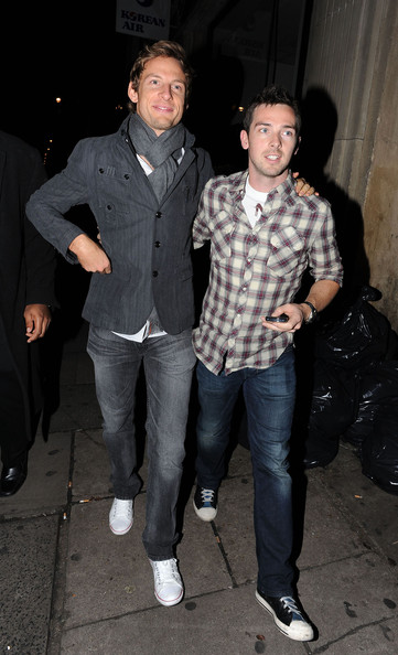 British formula one driver Jenson Button is in good spirits as he and a pal race out of Mahiki nightclub in London