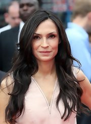 Famke Janssen showed off her rich chocolate locks with soft, effortless waves.