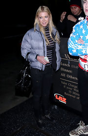 Tara Reid looked like a ski bunny in Hollywood in a silver puff coat.