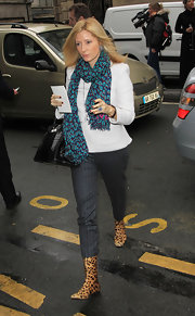 Princess Marie-Chantal took a walk on the wild side in a pair of flat mid-calf leopard print boots.