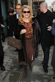Catherine Deneuve braved the cold at the Jean-Paul Gaultier fashion show in brown pointy suede boots.