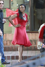 Tatyana Ali looked holiday-chi in this capped-sleeve red frock, which she sported on set of 'A Very Larry Christmas.'
