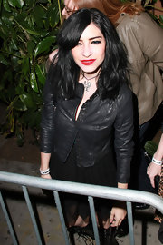 Lisa Origliasso wore a 'LOVE' pendant necklace at a movie premiere.