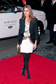 Olivia Palermo gave her white beaded dress a luxe finish with a dark blue feather-trim blazer.