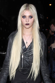 Taylor Momsen left the Viper Room in West Hollywood wearing her impossibly long hair straight with wispy bangs swept to the sides.