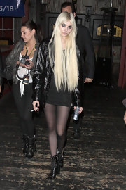 Taylor Momsen kept her look edgy with a shiny patent leather jacket.