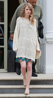 Taylor Swift wore a long, loosely crocheted sweater over a floral print dress while visiting MTV Studios in London.
