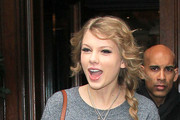 Taylor Swift steps out of her London Hotel and is greeted by a fan with a matching number '13' on their hand. The singer was wearing a Topshop knitted grey sweater with a panda printed on the front. Taylor is currently on her 'Speak Now' World Tour and is performing at the 02 Arena later today.