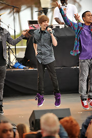 Justin bounces in these very purple hightops.  No wonder people are interested in Justin Bieber shoes!