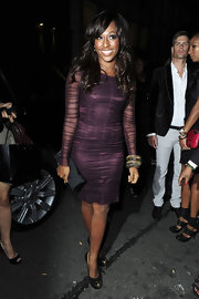 Alexandra paired her sheer deep purple dress with chunky bangle bracelets.