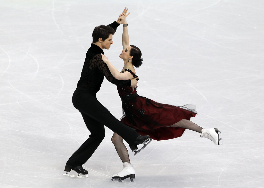 Which Pairs Figure Skating And Ice Dancing Couples Are: Tessa Virtue Loose Bun Looks