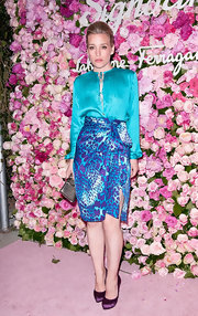 Piper Perabo was colorful at the Slavatore Ferragamo Signorina fragrance launch in NYC wearing this silk animal print skirt.