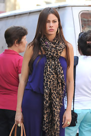 Sofia Vergara takes street style seriously: Here she finished her jumpsuit with a leopard print scarf and 18K gold Glamazon puffy hoop earrings.