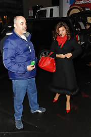 Tiffani Thiessen channeled Old Hollywood in a classy fur-trimmed black trenchcoat while out and about in New York City.