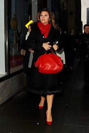Tiffani Thiessen looked super classy all the way down to her red pointy pumps while out and about in New York City.