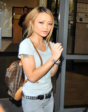 Tila opted for a hands-free approach with a designer backpack. This is a very stylish and casual look.