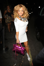 Tila showed off her unique pink metallic City bag while leaving Vendon night club.