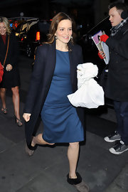 Tina Fey headed into 'The Today Show' in a sleek black coat, blue sheath and cozy slippers.