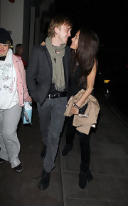 Tom Felton wore an olive scarf wrapped around his neck while he gazed lovingly at girlfriend Jade Olivia.