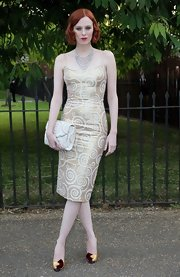 Karen Elson opted for a fun swirl-print dress in a soft metallic gold.