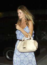 Rosie Huntington-Whiteley added glamor to a bohemian-chic maxi dress with bold chandelier earrings.