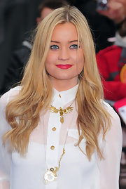 Laura Whitmore completed her look with dramatically lined eyes and strong lip.