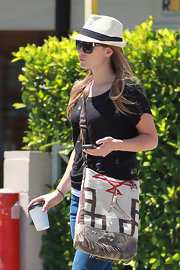 Olivia Wilde kept a low profile in LA carrying an earthy woven tribal satchel.