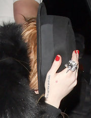 "The Brigitte Bardot quote on Lindsay's right hand reads ""I leave before being left. I decide."""