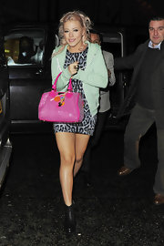 Amelia Lily gave her leopard print dress a playful finished with a glittery hot pink patent tote.