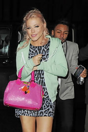 Amelia Lily dressed down her sultry animal print mini with a mint green hoodie.
