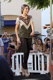 Nikki Reed wore a sequined-embellished tee in a rich olive-and-tan color palette to a taping of 'Extra'—it's the perfect choice for early fall, no?