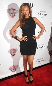 Tyra posed fiercely on the red carpet in this ribbed LBD.