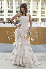 Tyra accessorized her opera dress with a gold snakeskin clutch.